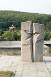 Star-shaped communist monument. From stone with forest on background Royalty Free Stock Photos