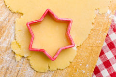 Star-shaped cookie cutter on dough Stock Photography