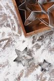 Star shaped cookie cutters. On floured table Royalty Free Stock Photography