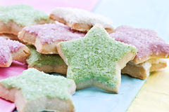 Star shaped cookies. On a multi-colored background Stock Images