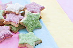 Star shaped cookies. On a multi-colored background Royalty Free Stock Photo