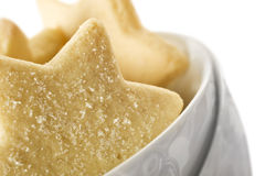 Star shaped cookies in a white bowl Royalty Free Stock Image