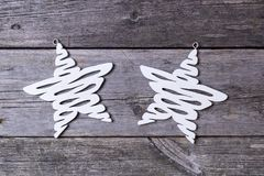 Star shaped decoration on wooden background. Two Christmas decoration on rustic wooden shaped as stars stock images