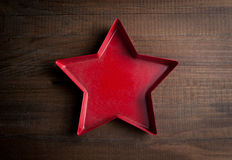 Star-shaped form for candle on wooden background Royalty Free Stock Images