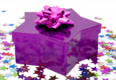 Star shaped gift box with a pink rosette Royalty Free Stock Photo