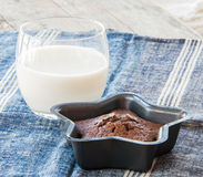 Star-shaped gingerbread cake. With glass of milk Royalty Free Stock Images