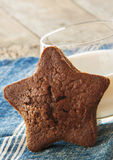 Star-shaped gingerbread cake with glass of milk Royalty Free Stock Photos