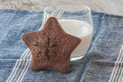 Star-shaped gingerbread cake with glass of milk Royalty Free Stock Images