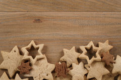 Star shaped gingerbread and chocolate cookies on wooden background border Royalty Free Stock Photos