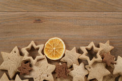 Star shaped gingerbread and chocolate cookies on wooden background border Stock Photo