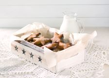 Star shaped gingerbread. Cookies for Santa. Rustic style breakfast. stock photo