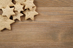 Star shaped gingerbread cookies on wooden background border Stock Photography