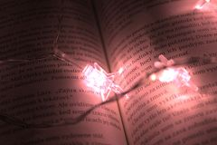 Star Shaped Lights On A Book Royalty Free Stock Images