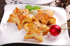 Star shaped puff pastries with mushroom fiiling for christmas Stock Photo