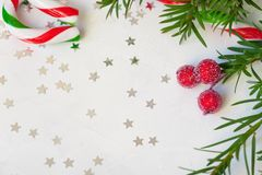 Star shaped red confetti on white background. festive background. Christmas Star with copy space for your text on a white background stock photo
