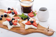 Star shaped sandwiches with berries and cheese Stock Images