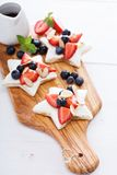 Star shaped sandwiches with berries and cheese Stock Image