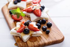 Star shaped sandwiches with berries and cheese Royalty Free Stock Image