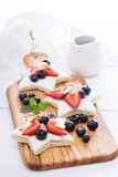 Star shaped sandwiches with berries and cheese Stock Photography