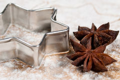Star-shaped and star anise in the flour V2. Star-shaped and star anise are in the flour Close up Royalty Free Stock Image