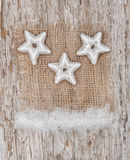 Star shapes and burlap textile on the old wood Stock Photography