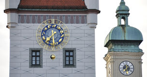 Star sign clock. Munich - the star sign clock of the old town hall (today housing the toy museum) with the clock of the Heilig-Geist Kirche (church of the holy Stock Photography