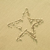 Star sign on a sand Royalty Free Stock Photos
