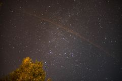 Star sky at the night with a comet trail. Near Tula, Russia royalty free stock images