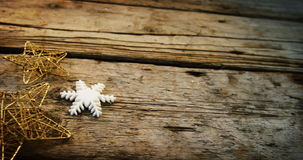 Star and snowflake on wooden plank stock video