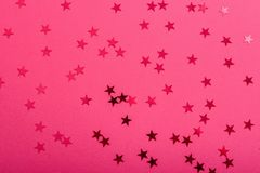 Star sprinkles on pink. royalty free stock photo