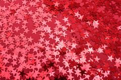 Star sprinkles on red. royalty free stock photos