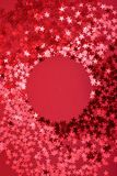 Star sprinkles on red with round space. royalty free stock photo