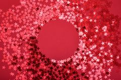 Star sprinkles on red with round space royalty free stock image
