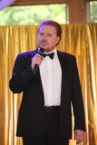 Star of stage, Opera singer, tenor Sergey Muravyov acts, sings in the black concert tuxedo coat. Stock Photo