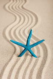 Star sticking out in the sand Royalty Free Stock Image