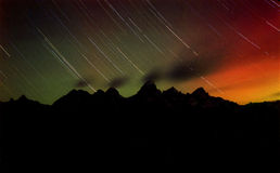 Star Streaks Mountain Peaks & the Aurora Borealis. Star Streaks Mountain Peaks & the Aurora Borealis photographed in Grand Teton National Park, Wyoming Royalty Free Stock Photo