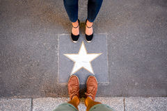 Star on the street in Bologna. Top view on the gold star with legs on the street in Bologna city Stock Images