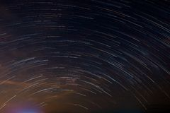 Star tail as light line swirl on night sky. By star stax from multi shooting picture royalty free stock photo