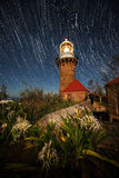 Star tail with Light house Stock Photography