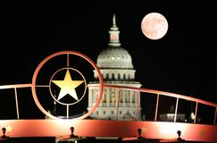 Star of Texas with the State Capitol Building at Night. A shot of the star of Texas with the Texas State Capitol Building and the moon in the background Royalty Free Stock Images