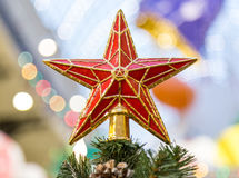 Star on top of beautiful christmas tree Royalty Free Stock Photo