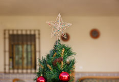 A star on top of a christmas tree Stock Photography