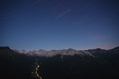 Star tracks over mountain range Stock Photos