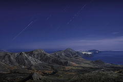 Star tracks over mountains stock photography
