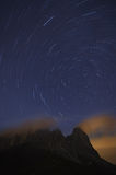 Star tracks over Sassolungo mountain range Stock Photo