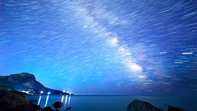 Star tracks over the sea. Time Lapse