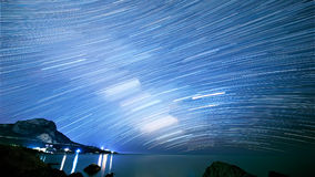 Star tracks over the sea. Time Lapse.  Royalty Free Stock Photos