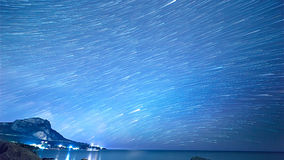Star tracks over the sea. Time Lapse.  Royalty Free Stock Images