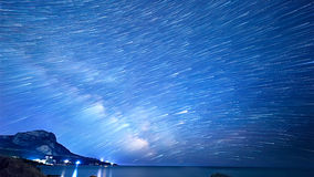 Star tracks over the sea. Time Lapse.  Stock Photos