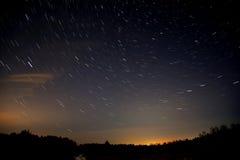 Star tracks sky forest stock photo